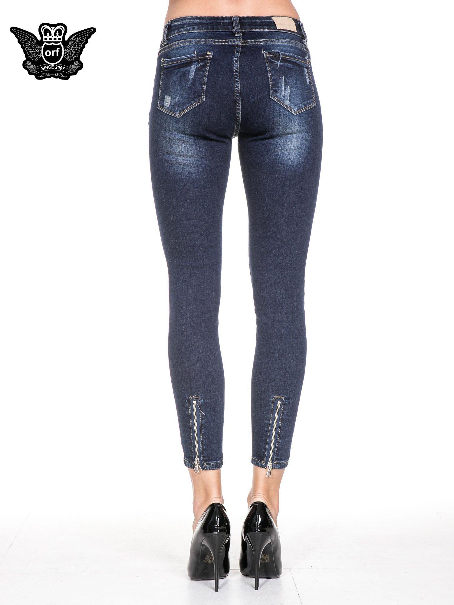 Granatowe spodnie skinny jeans z zamkami na dole                                  zdj.                                  6