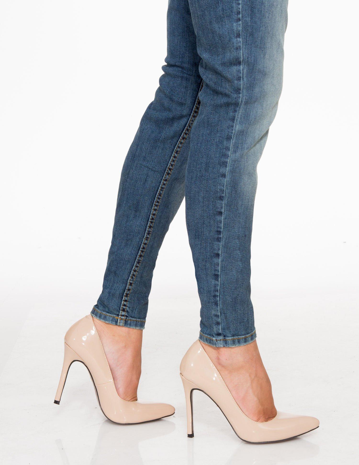Jasnoniebieskie spodnie jeansowe typu rurki z cieniowaniem                                  zdj.                                  7