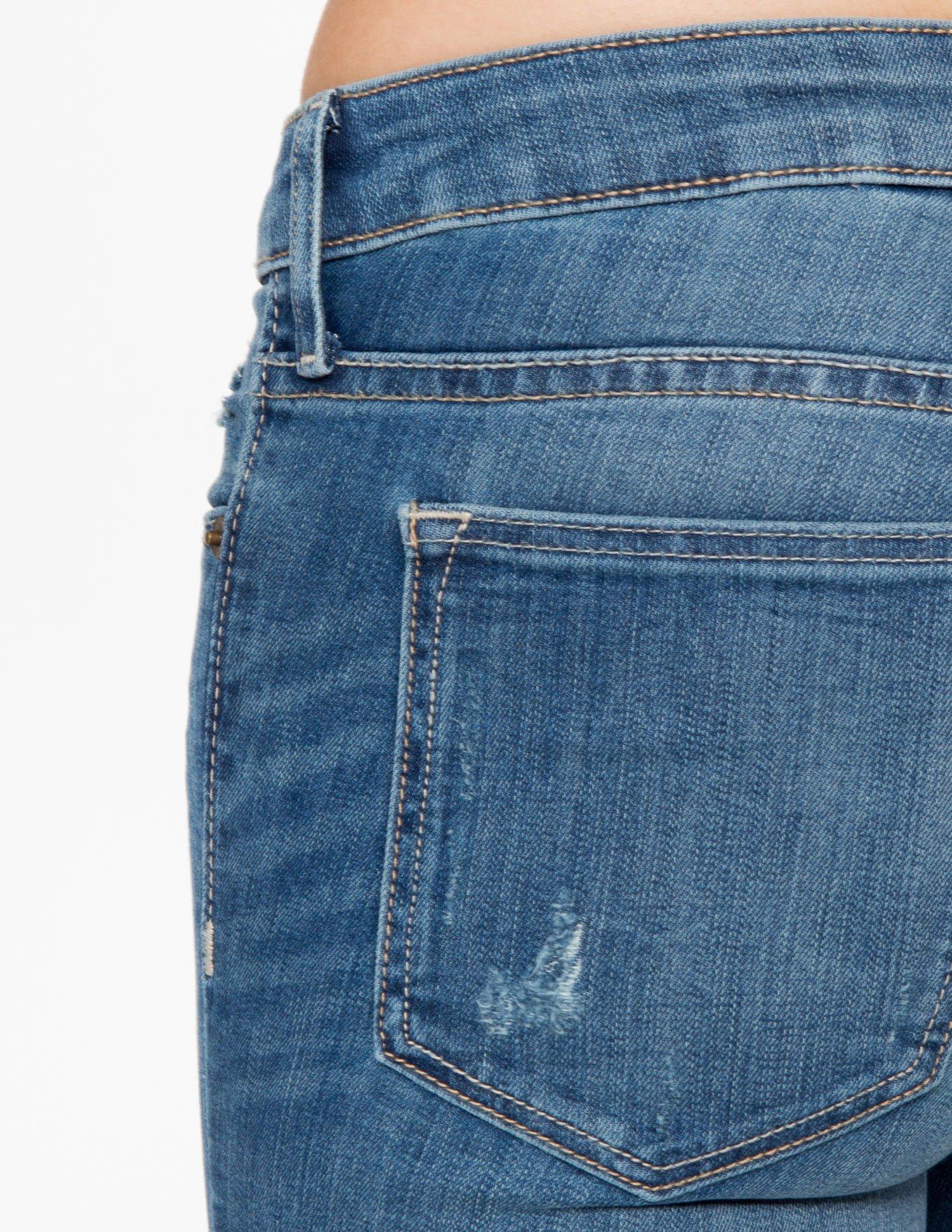 Jasnoniebieskie spodnie jeansowe z przetarciami                                  zdj.                                  7