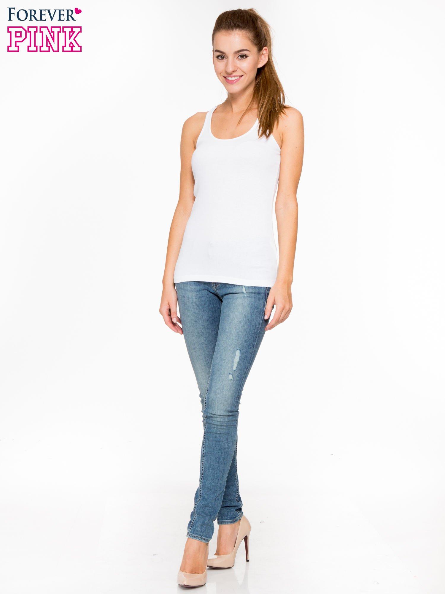 Jasnoniebieskie spodnie typu skinny jeans z przetarciami                                  zdj.                                  2