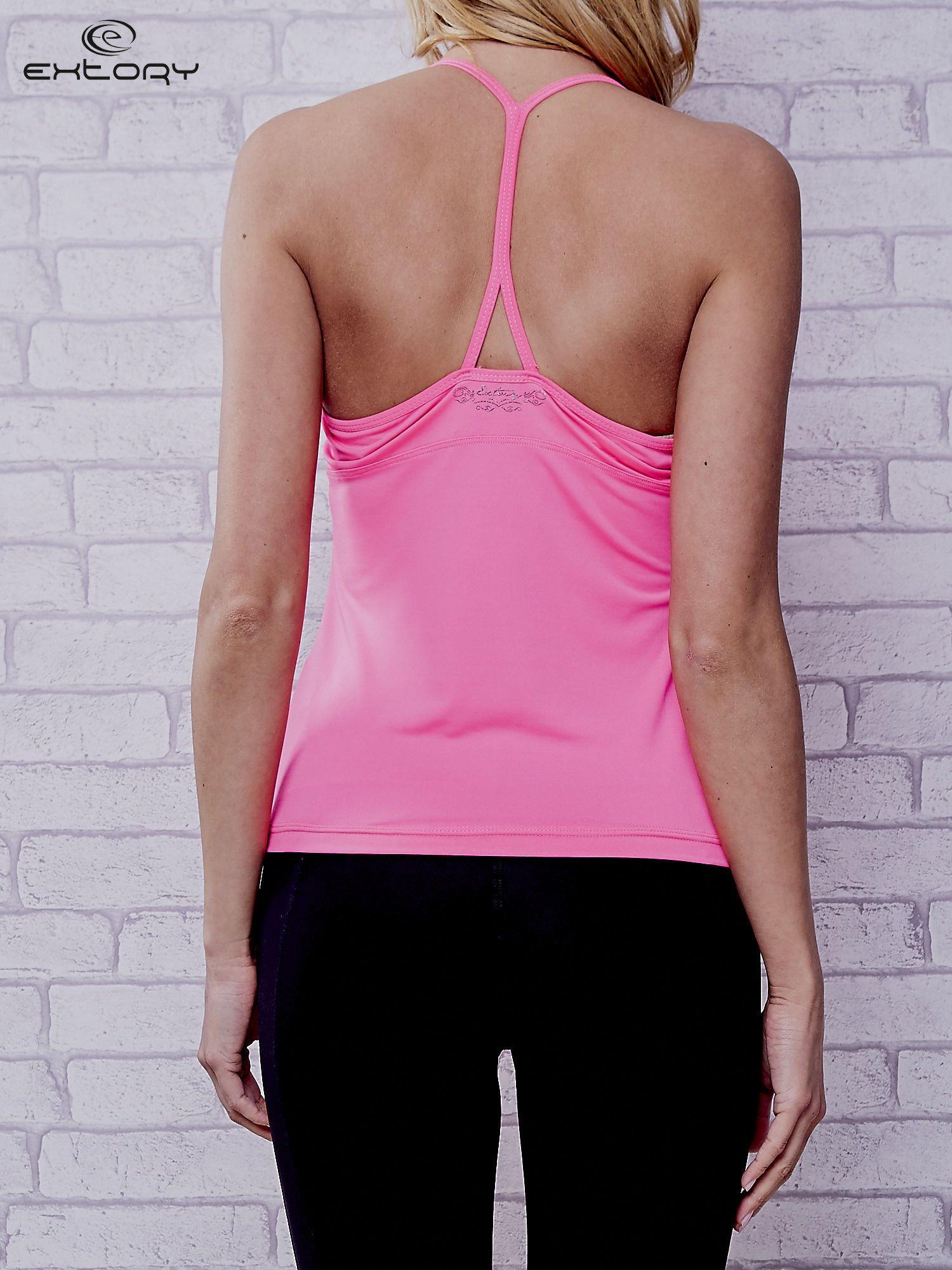 Jasnoróżowy top sportowy z siateczką i ramiączkami w kształcie litery T na plecach                                  zdj.                                  4