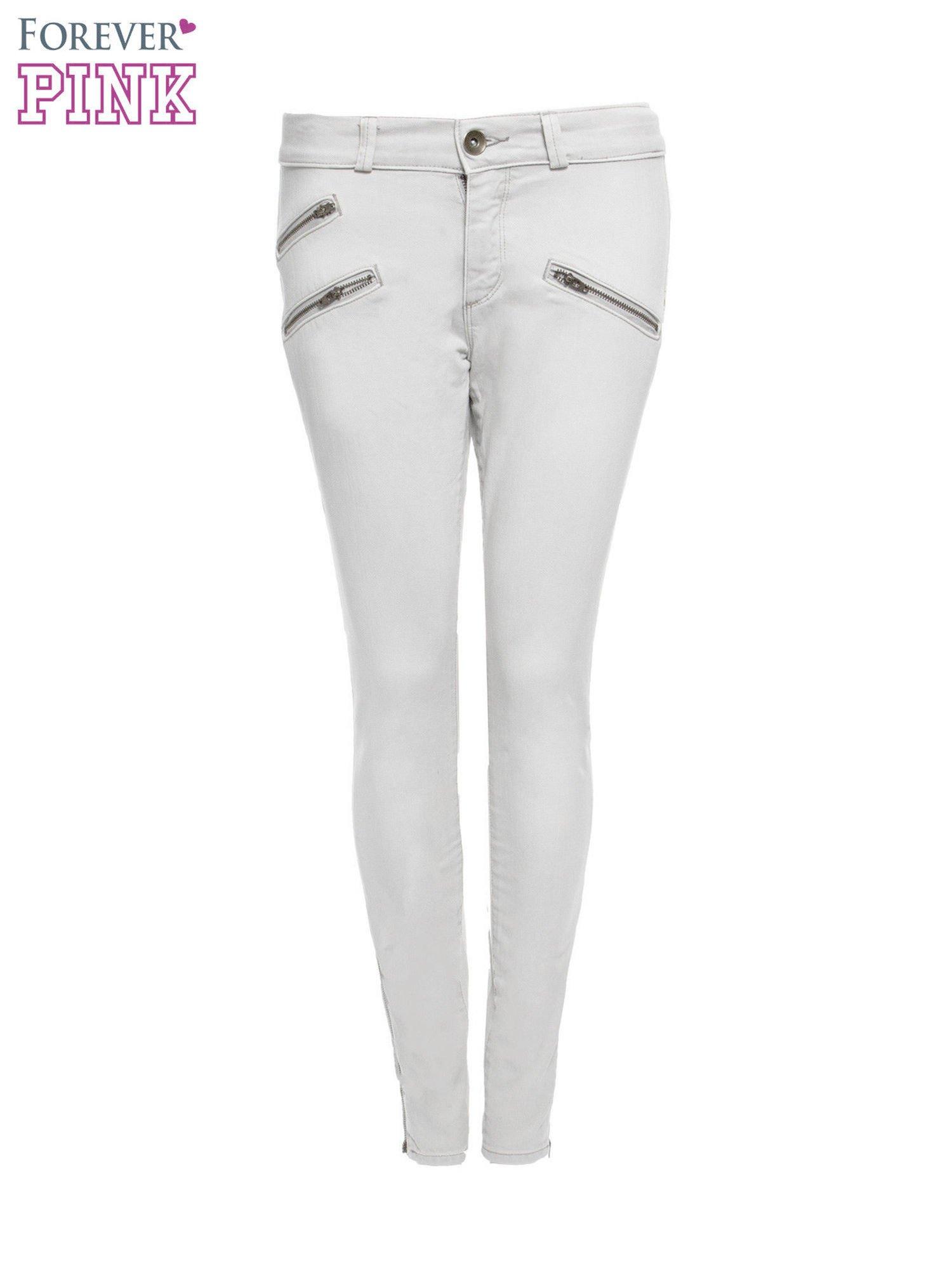 Jasnoszare spodnie jeansowe typu skinny z suwakami na górze i przy nogawkach                                  zdj.                                  4