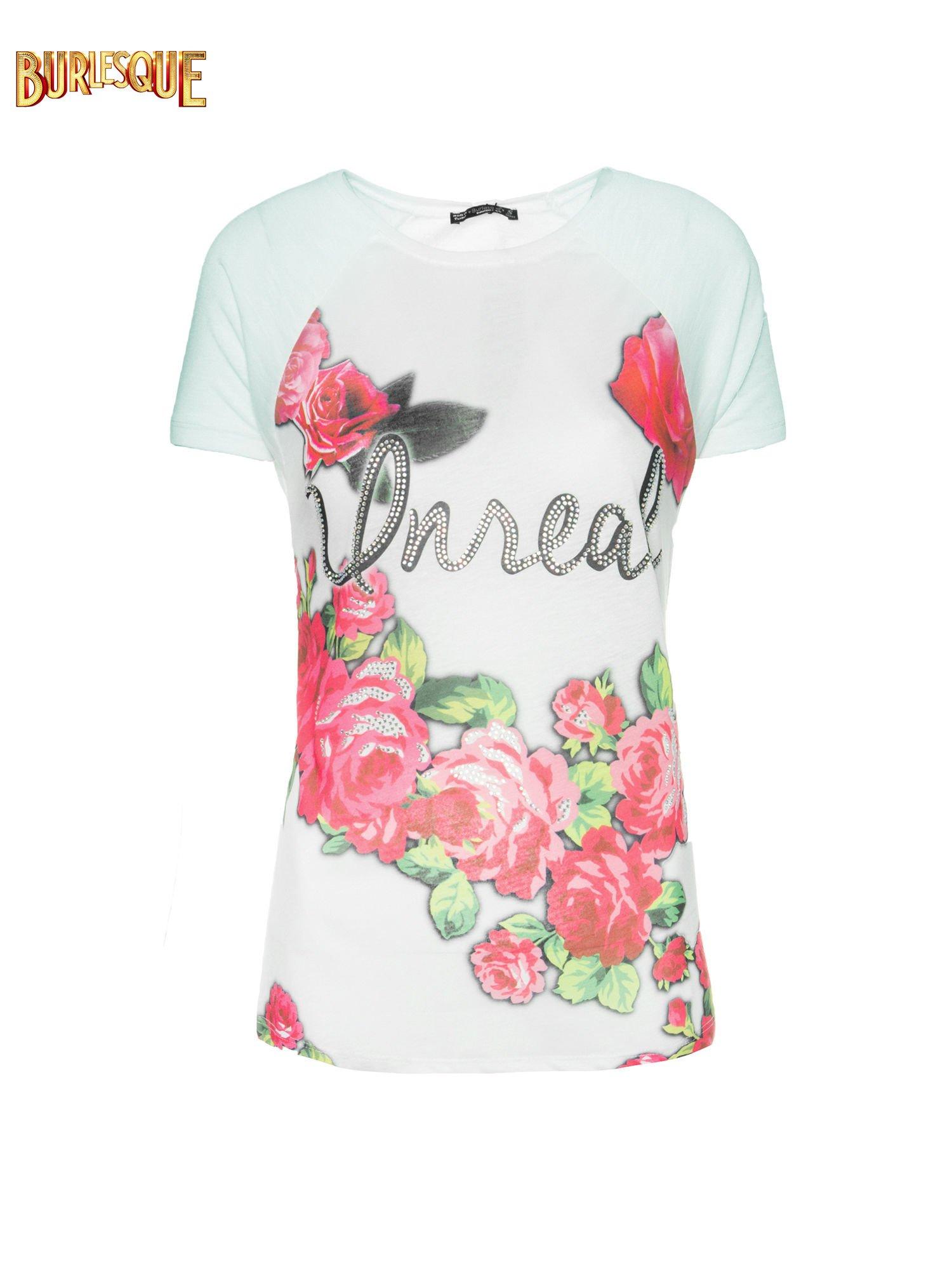 Jasnozielony t-shirt z kwiatowym nadrukiem i napisem UNREAL                                  zdj.                                  1