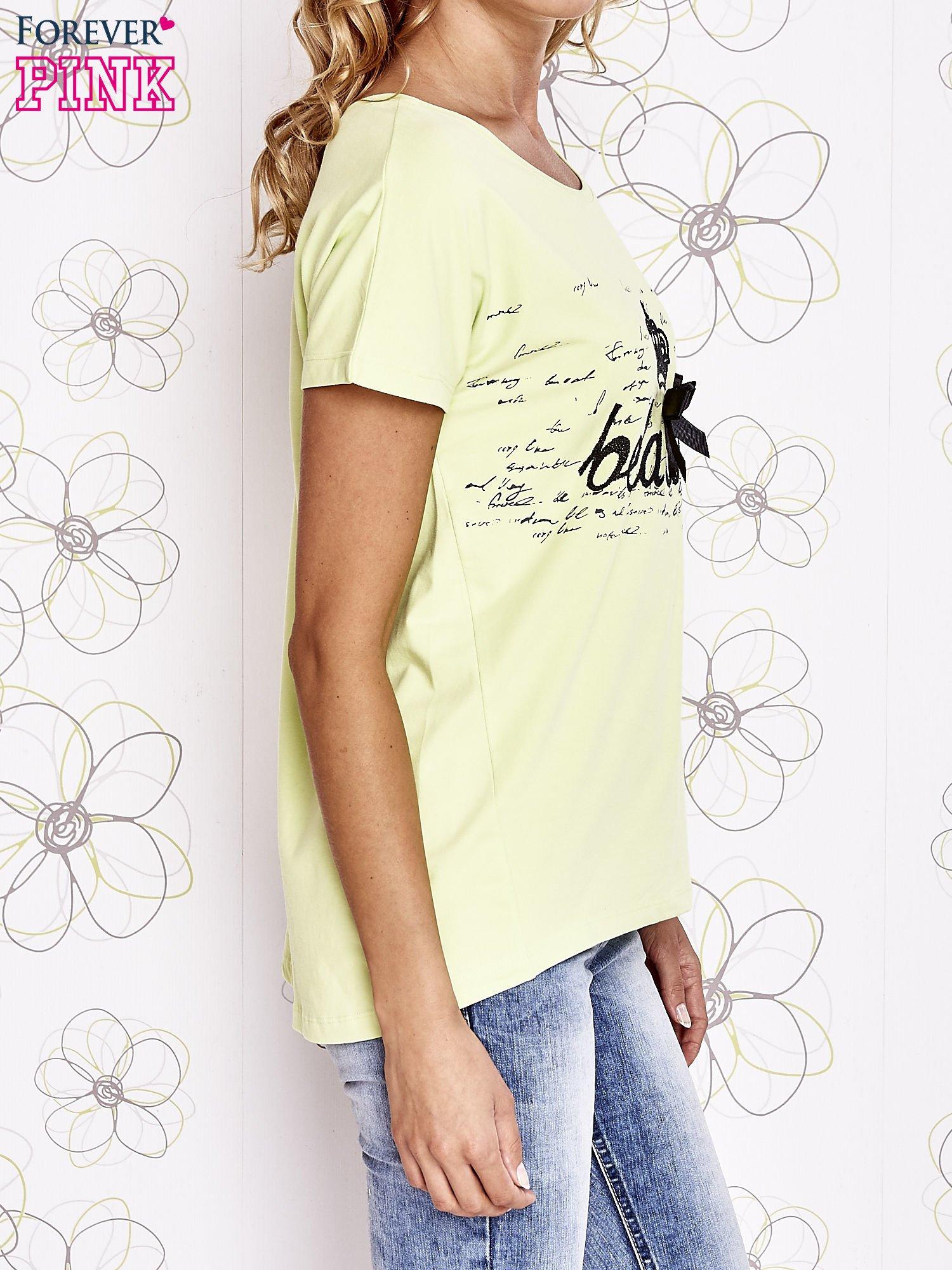 Limonkowy t-shirt z ozdobnym napisem i kokardą                                  zdj.                                  3