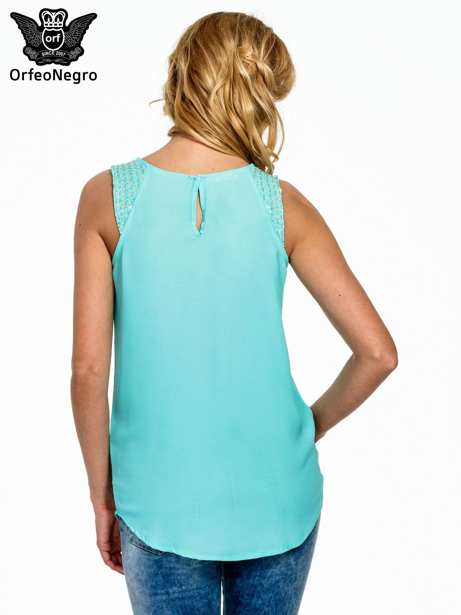 Miętowa bluzka koszulowa z koralikami przy ramionach                                  zdj.                                  4