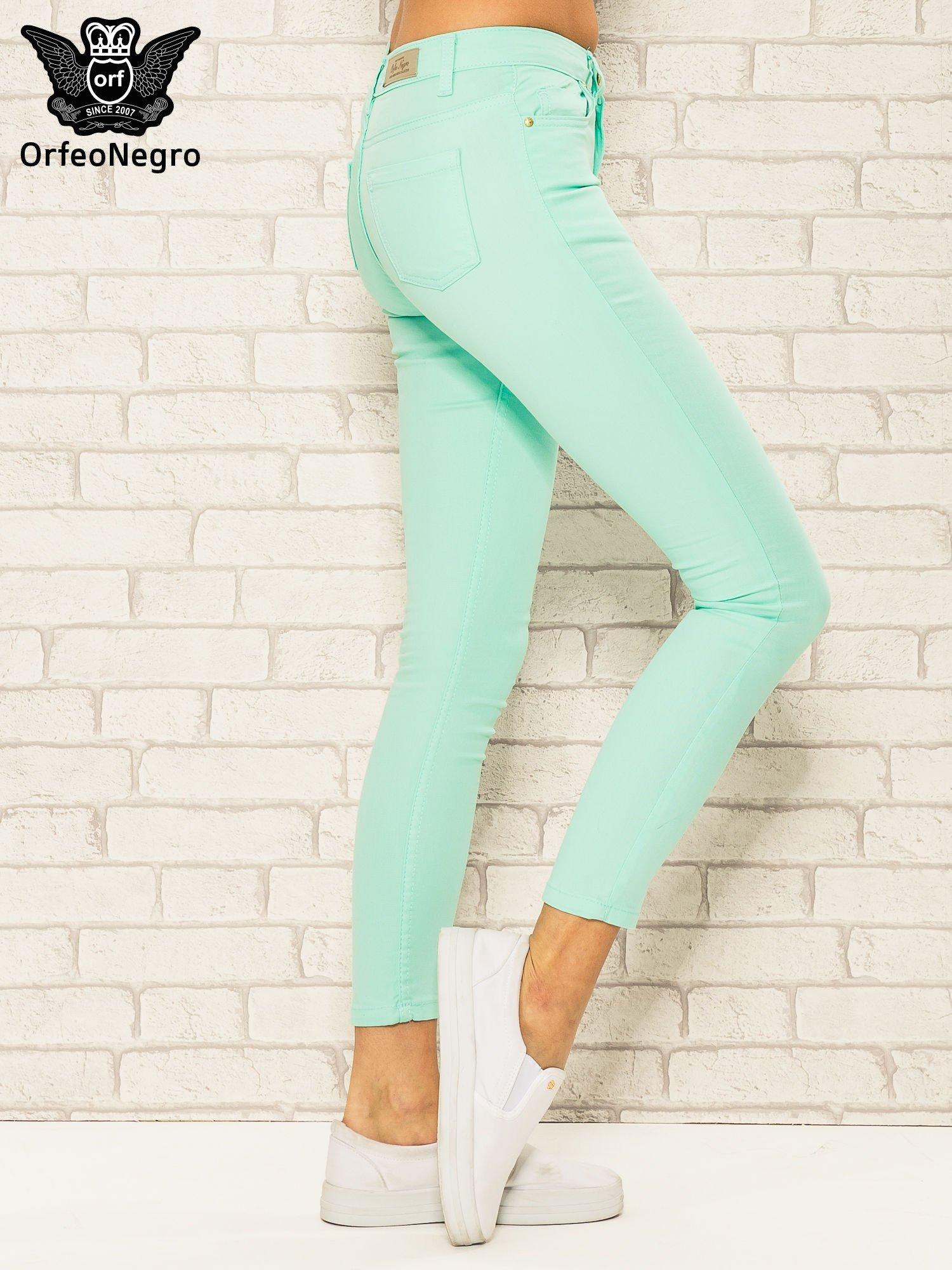 Miętowe spodnie rurki skinny z kieszeniami                                  zdj.                                  3