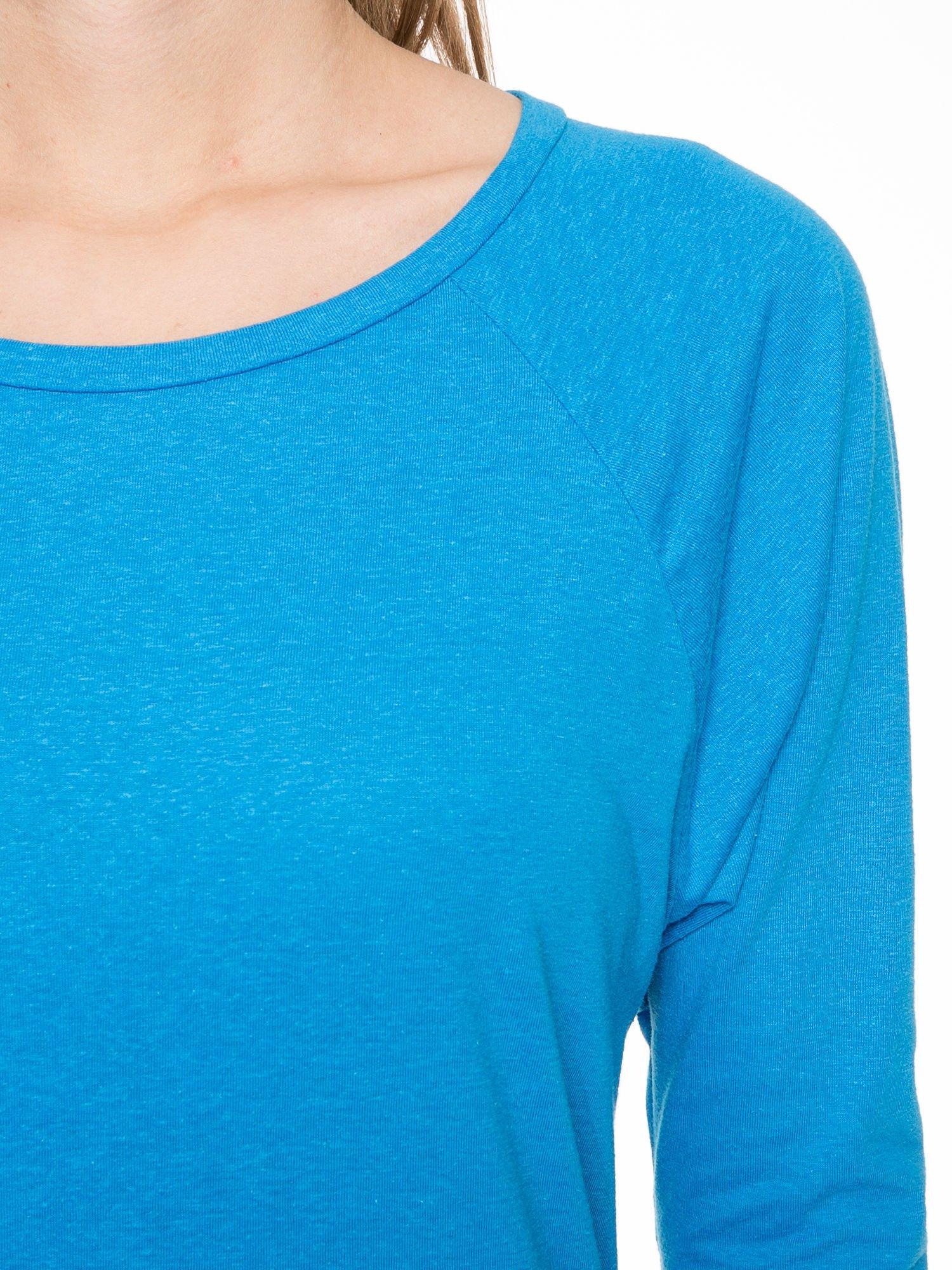 Niebieska bawełniana bluzka z rękawami typu reglan                                  zdj.                                  3