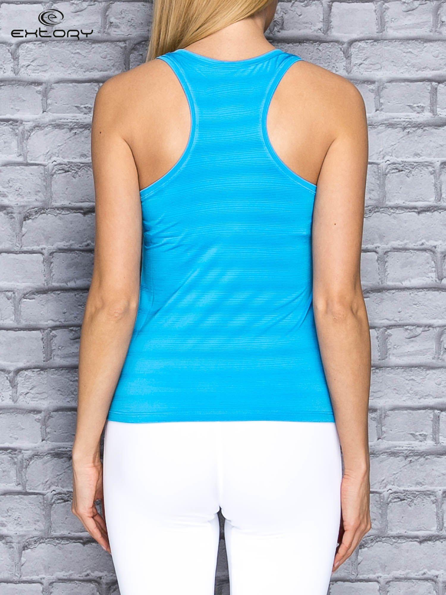Niebieski top sportowy V-neck w paseczki                                  zdj.                                  2