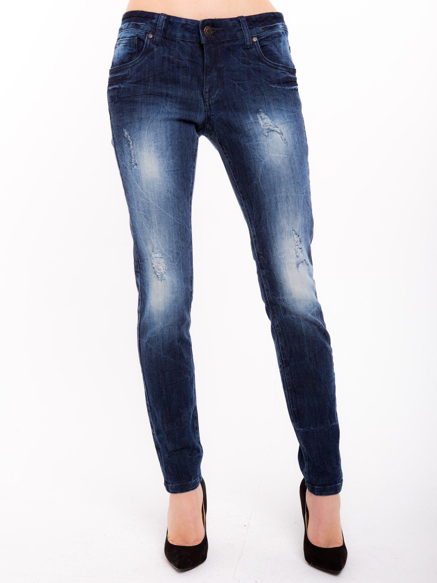 Niebieskie jeansy rurki z cieniowaniem                                  zdj.                                  1
