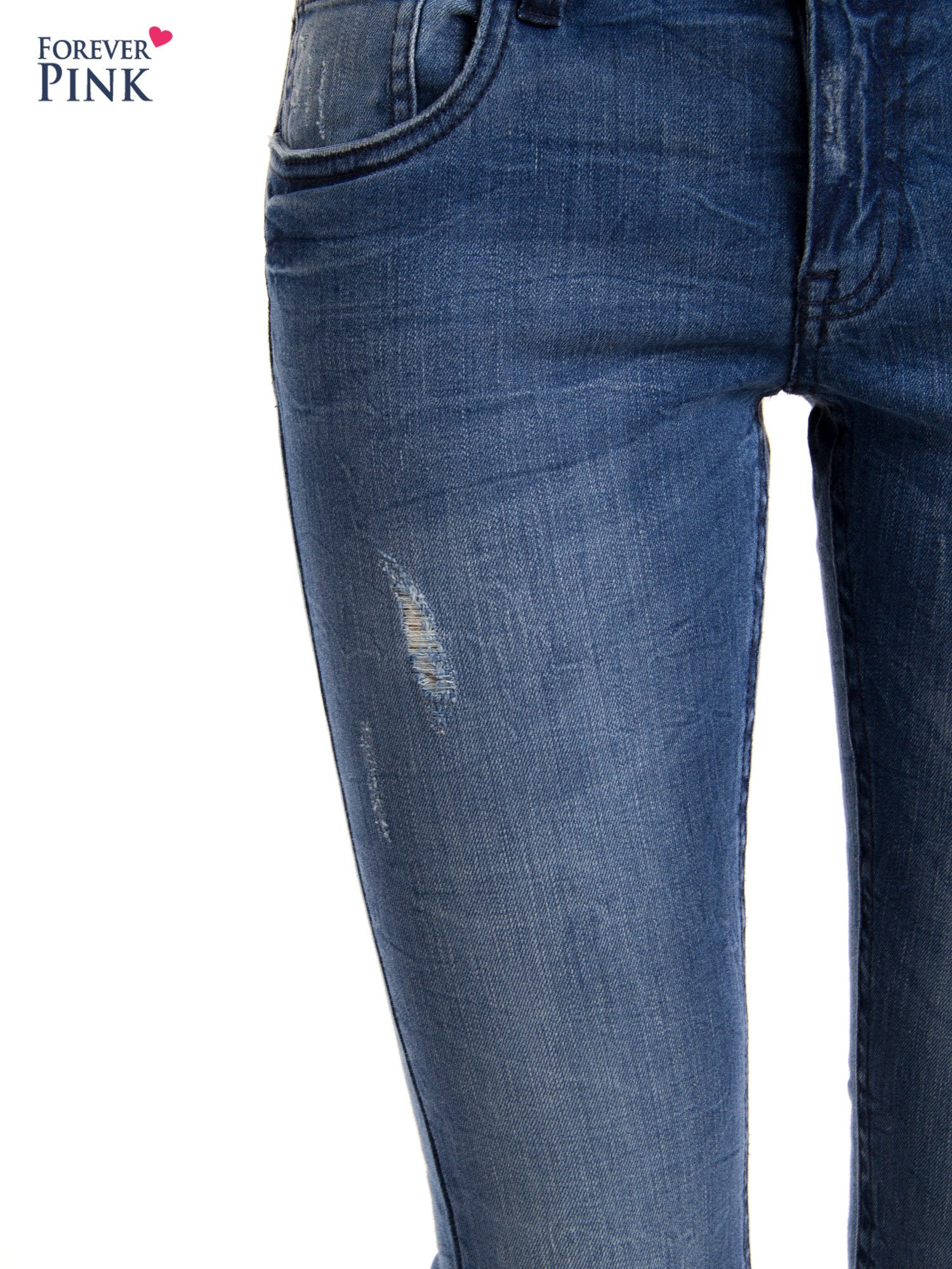 Niebieskie jeansy rurki z przetarciami                                  zdj.                                  5