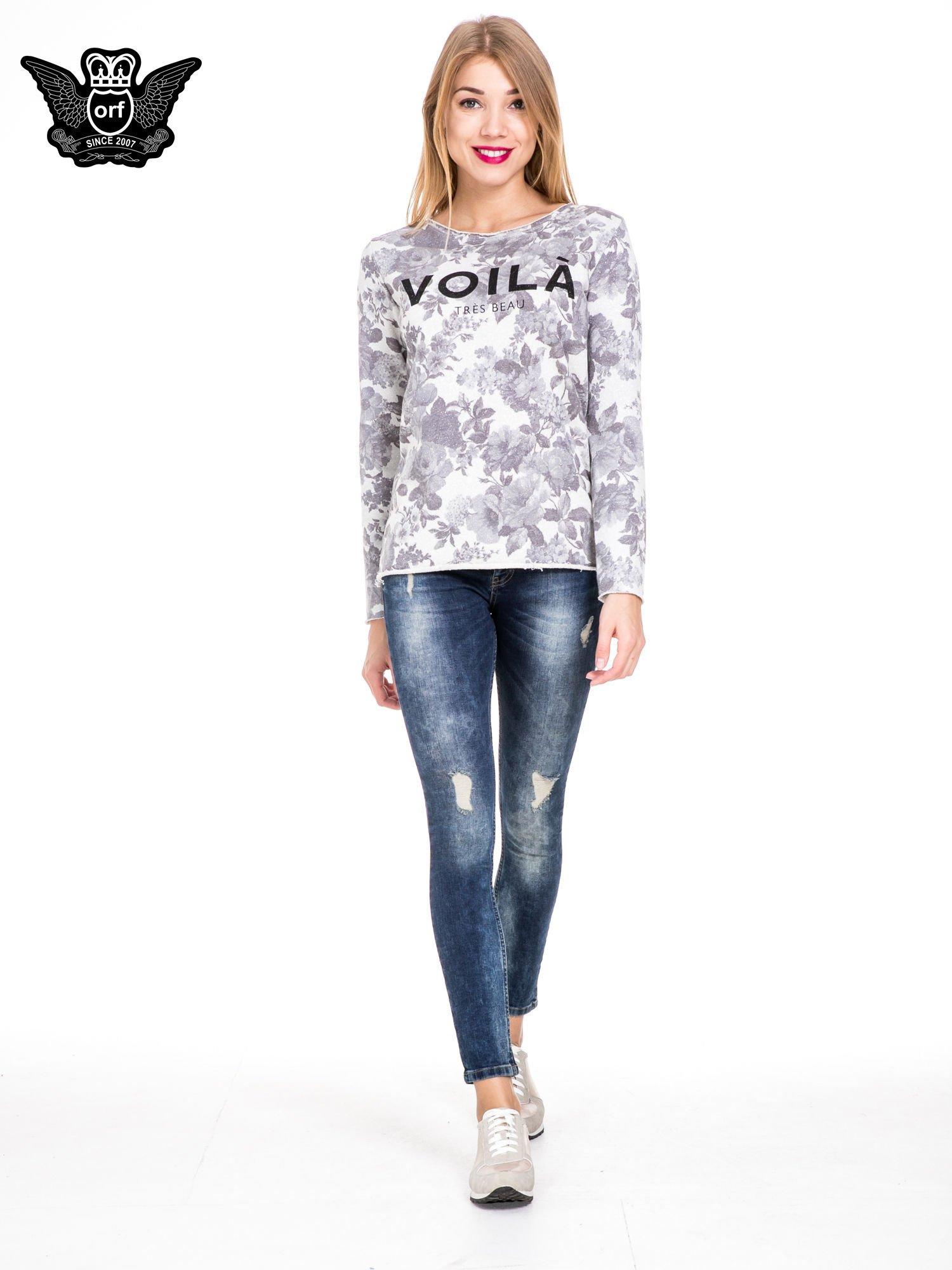 Niebieskie spodnie jeansowe rurki z lekkim dekatyzowaniem i przetarciami                                  zdj.                                  2