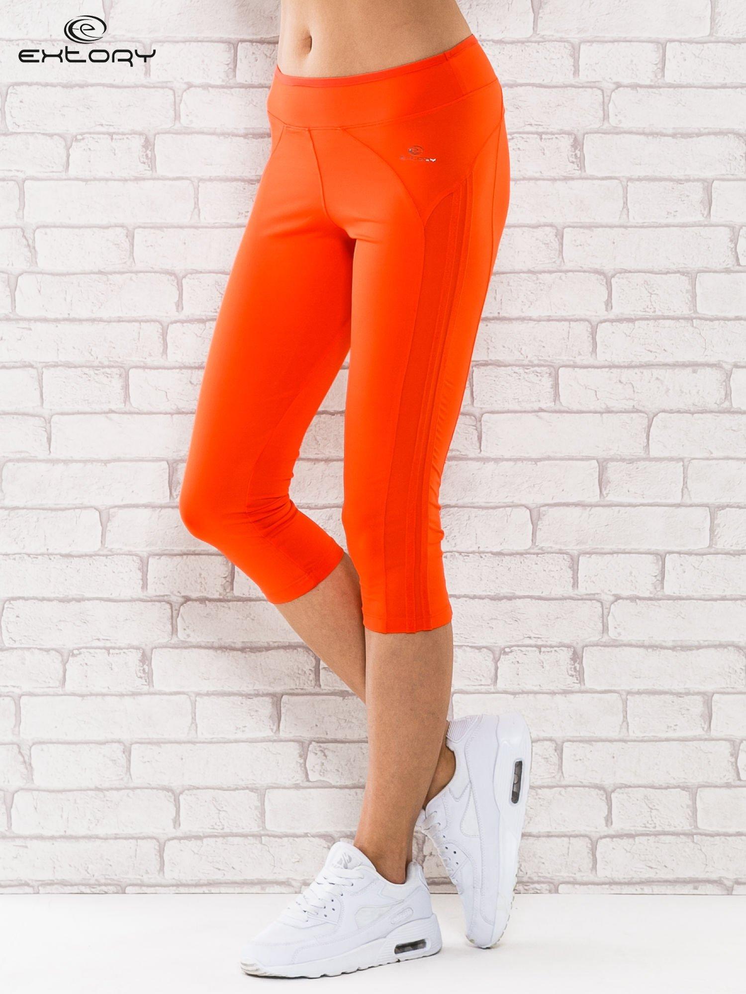 Pomarańczowe legginsy 3/4 sportowe termalne z lampasami                                  zdj.                                  1