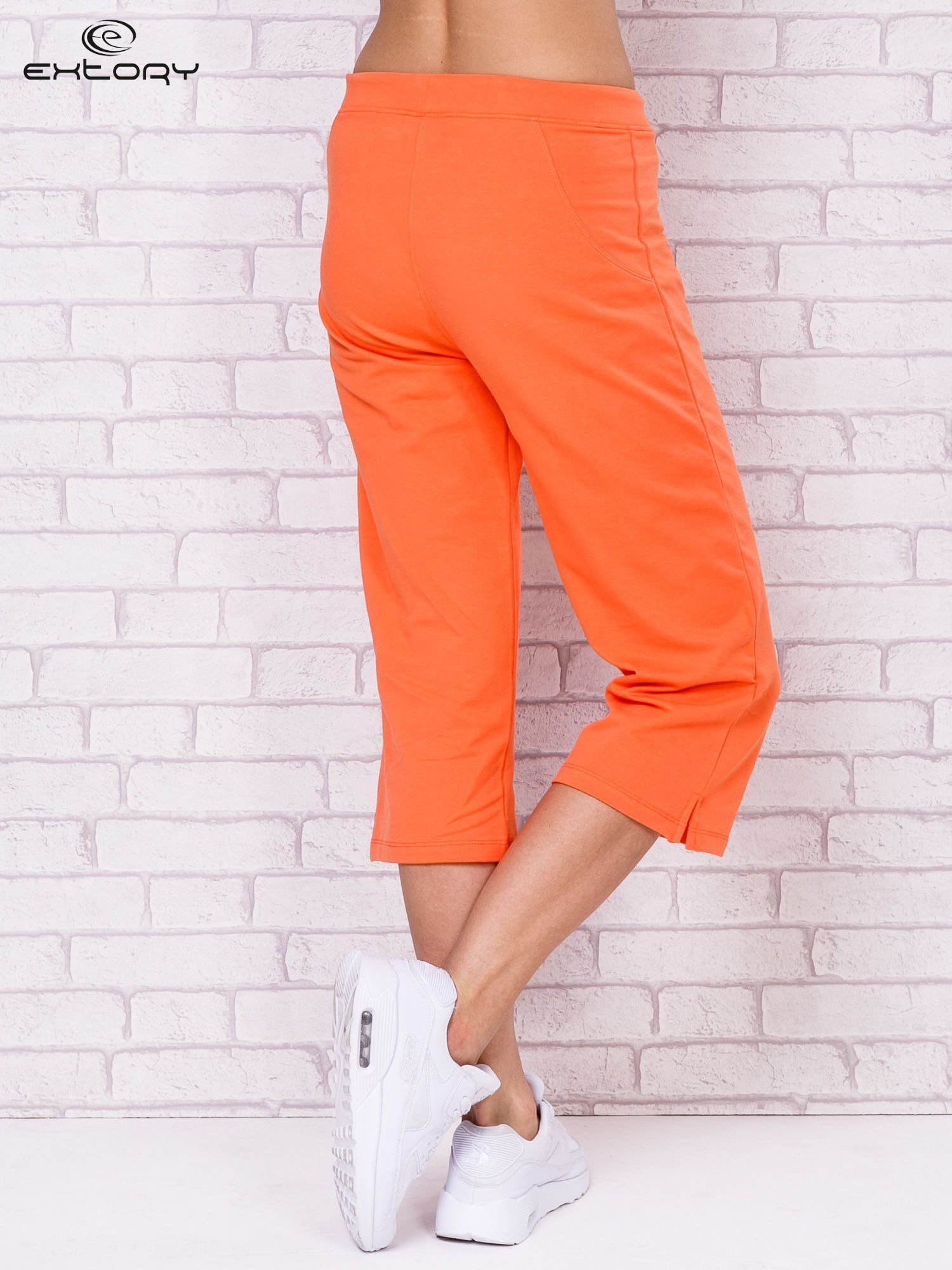 Pomarańczowe spodnie sportowe capri                                  zdj.                                  2