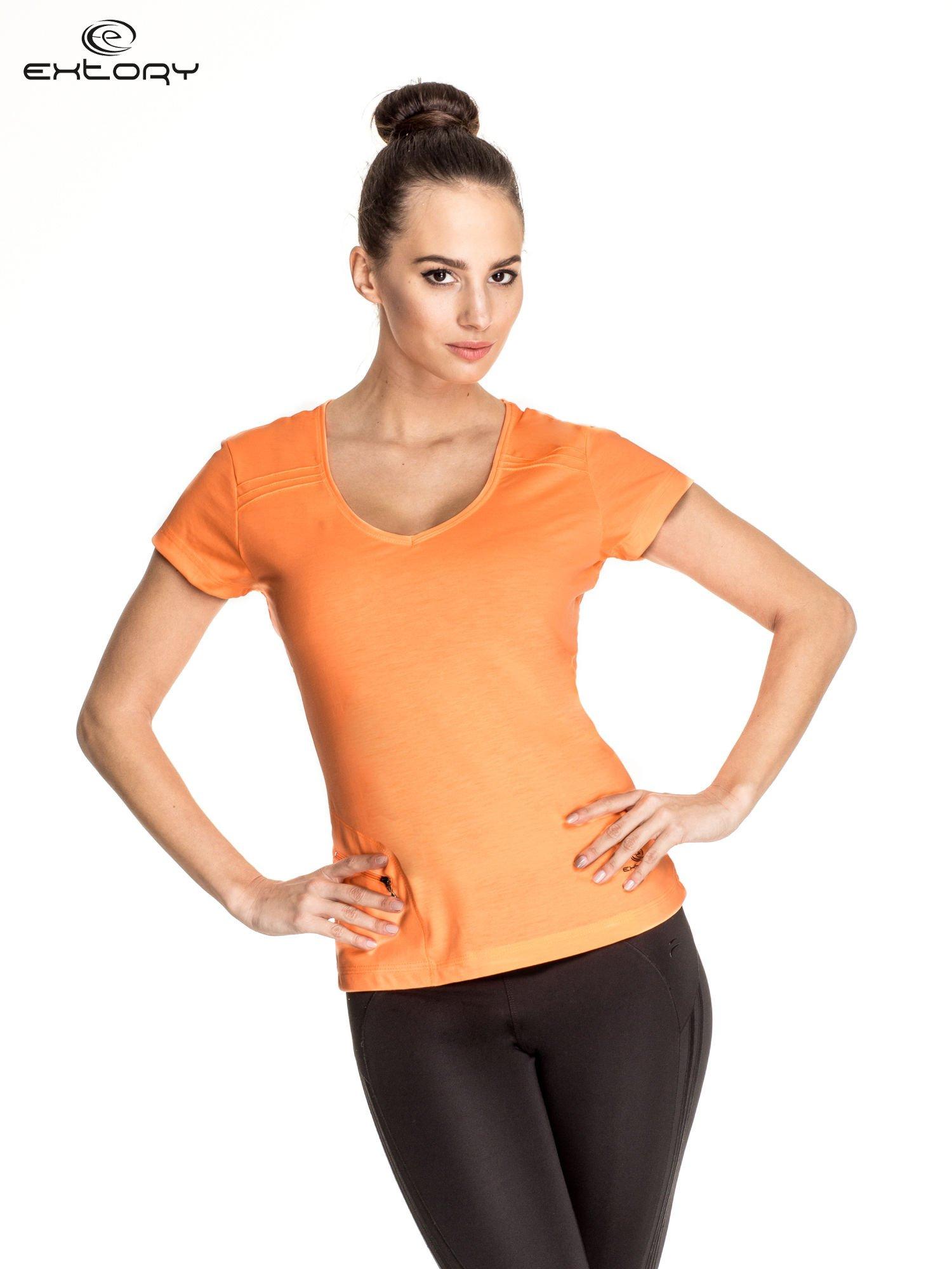 Pomarańczowy damski t-shirt sportowy z kieszonką                                  zdj.                                  1