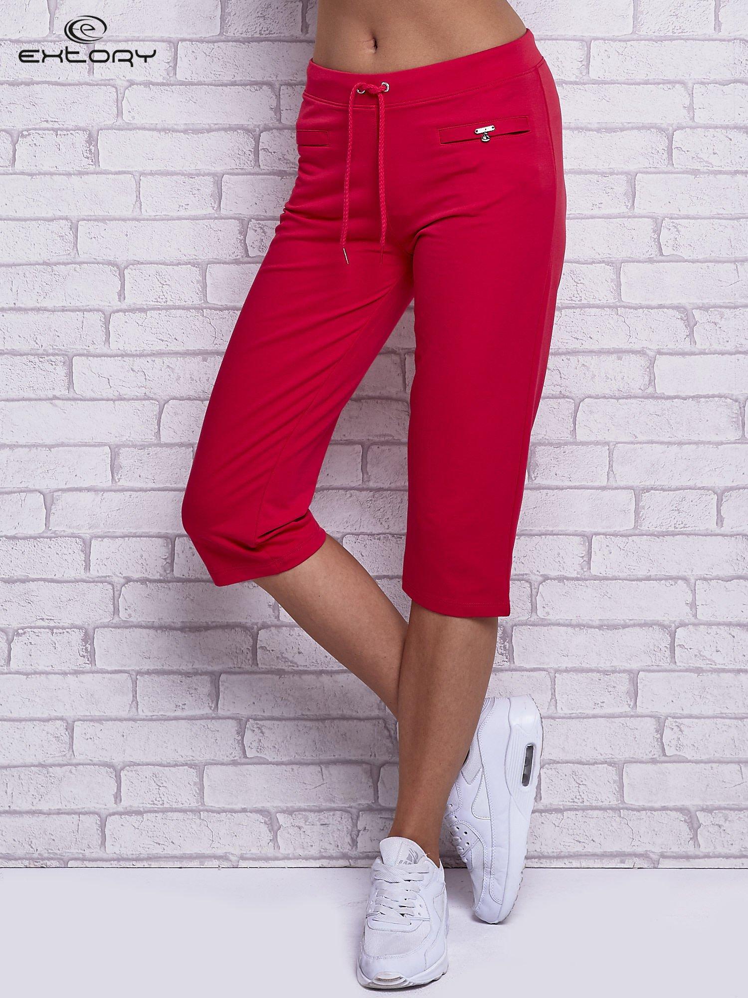 Różowe spodnie capri z wszytymi kieszonkami                                  zdj.                                  1