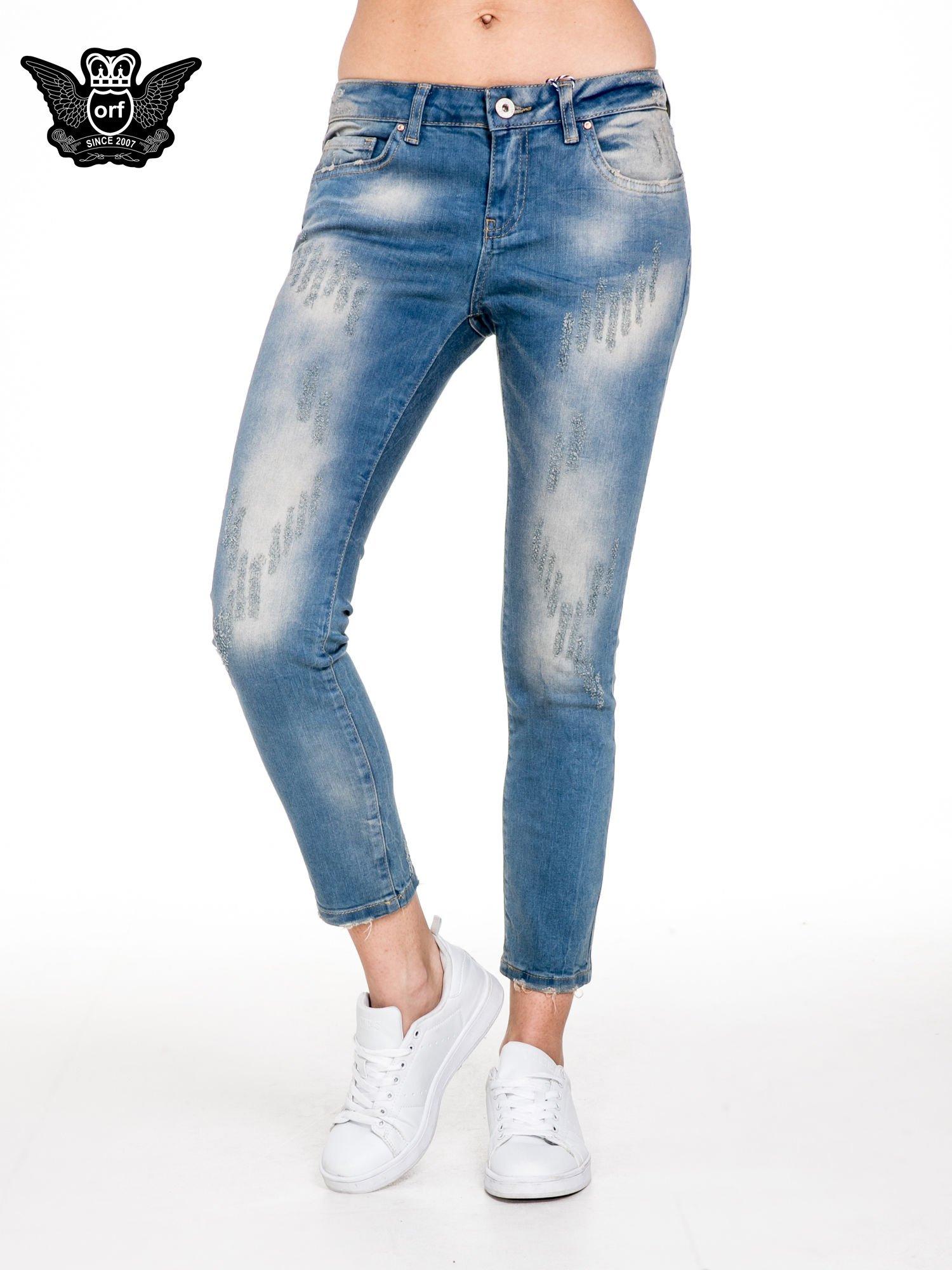 Spodnie jeansowe rurki z pionowymi przetarciami                                  zdj.                                  1
