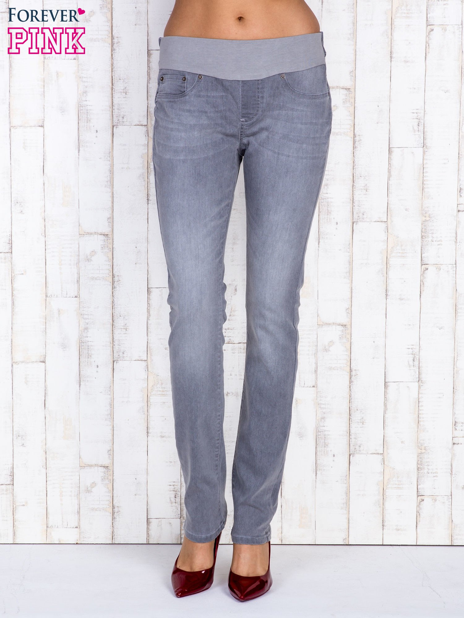 Szare jeansowe spodnie z przetarciami i na gumkę w pasie                                  zdj.                                  1