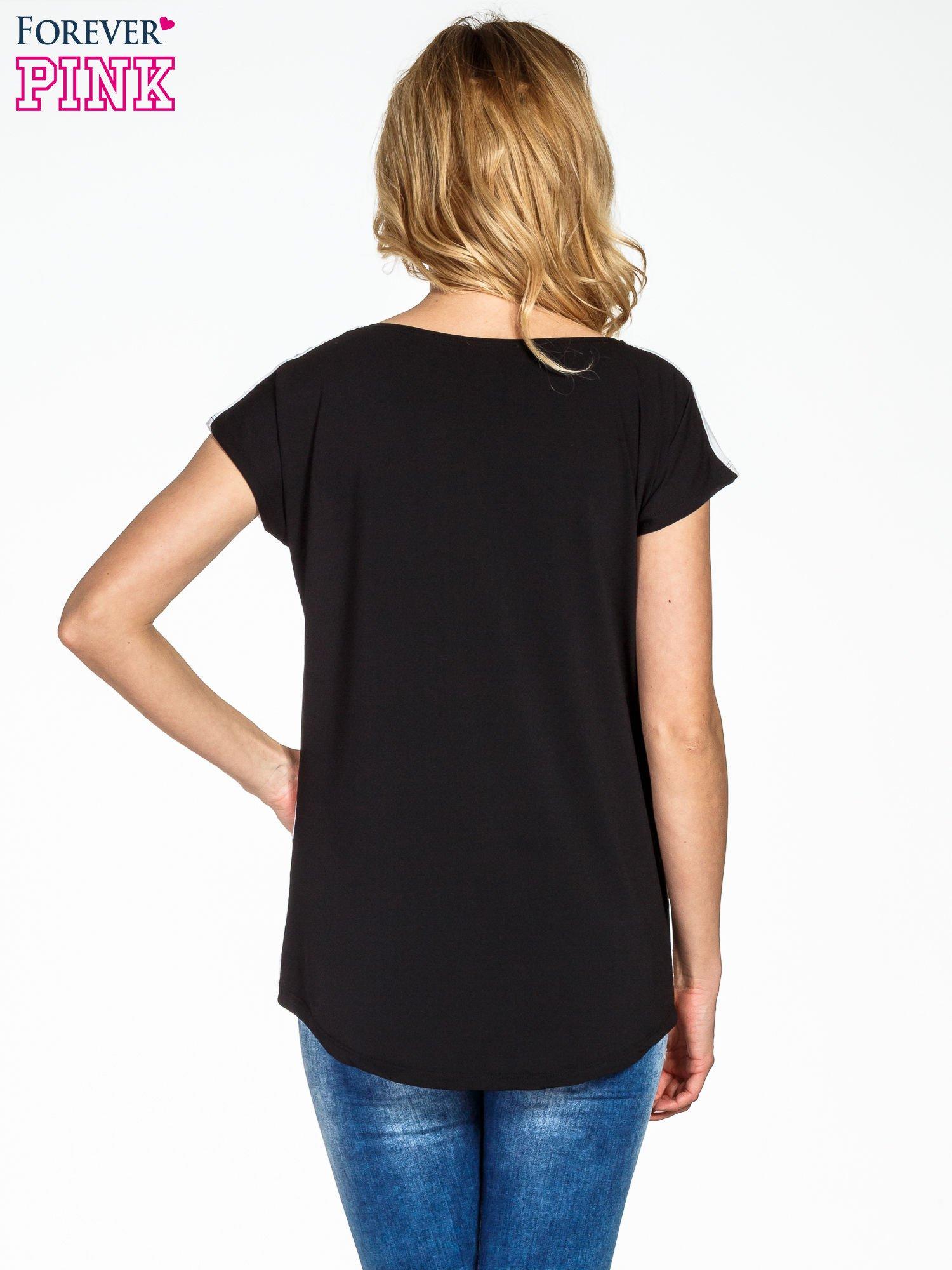 T-shirt w biało-czarne paski                                  zdj.                                  4