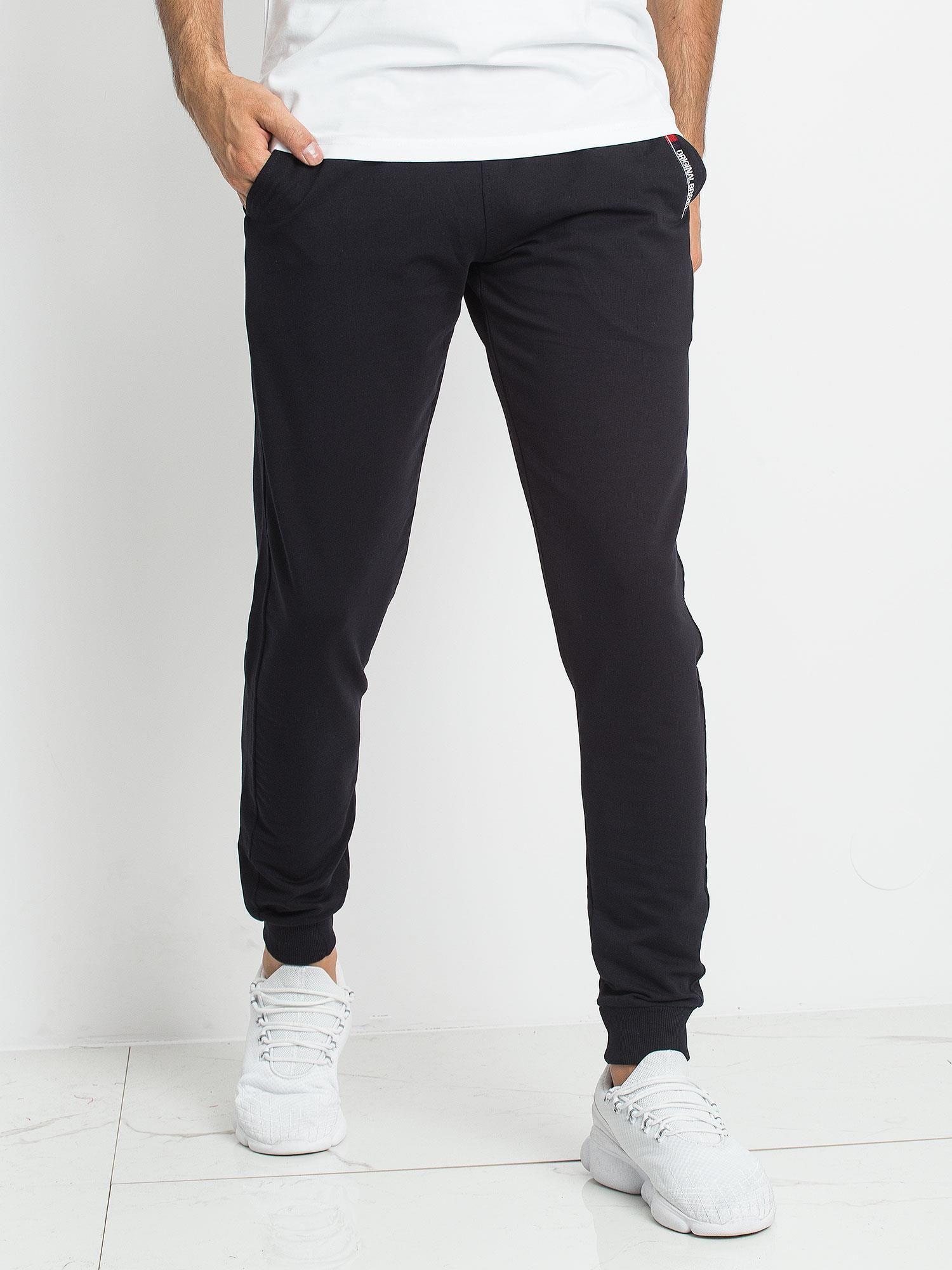 4bf4c6a0006caa TOMMY LIFE Czarne męskie dresy - Mężczyźni Spodnie dresowe męskie ...