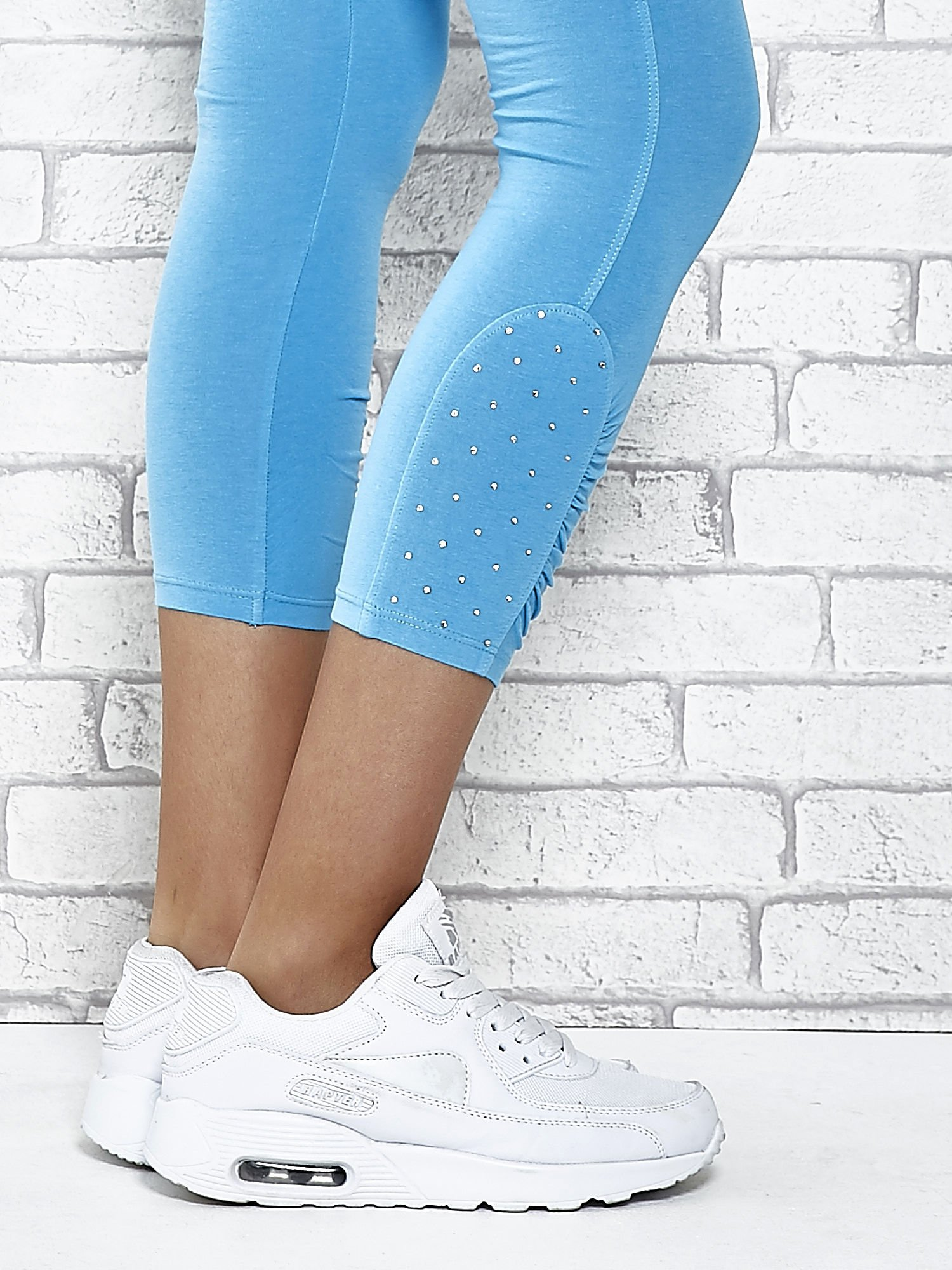 Turkusowe legginsy sportowe z aplikacją z dżetów na nogawkach                                  zdj.                                  7