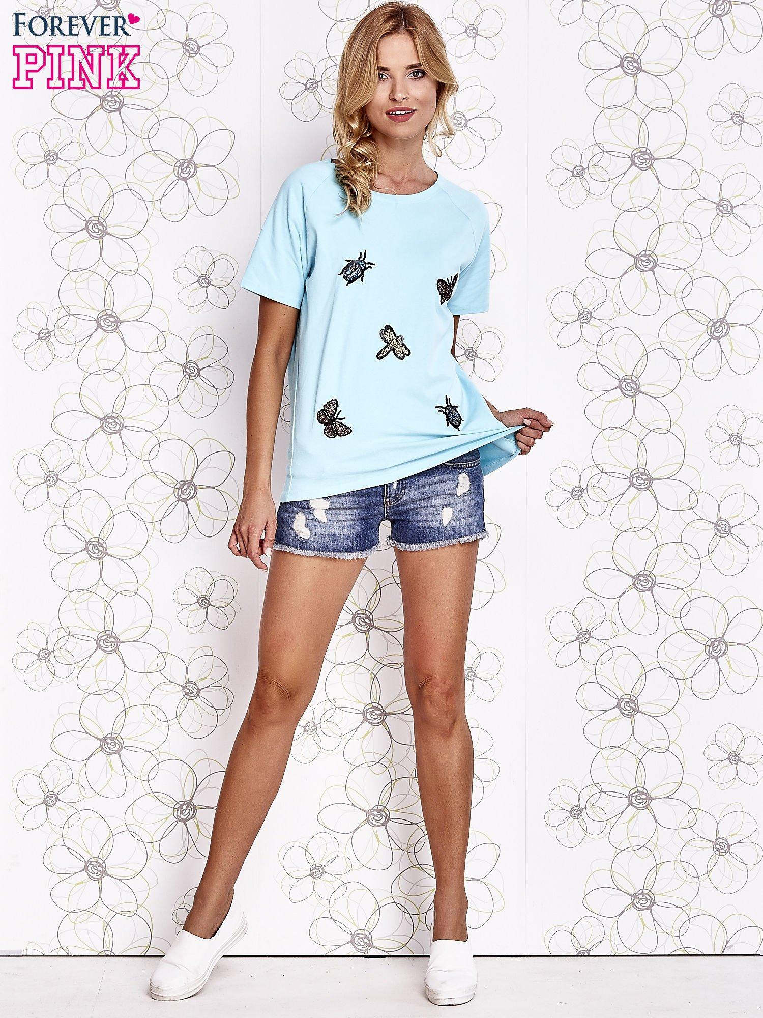 Turkusowy t-shirt z aplikacją owadów                                   zdj.                                  2