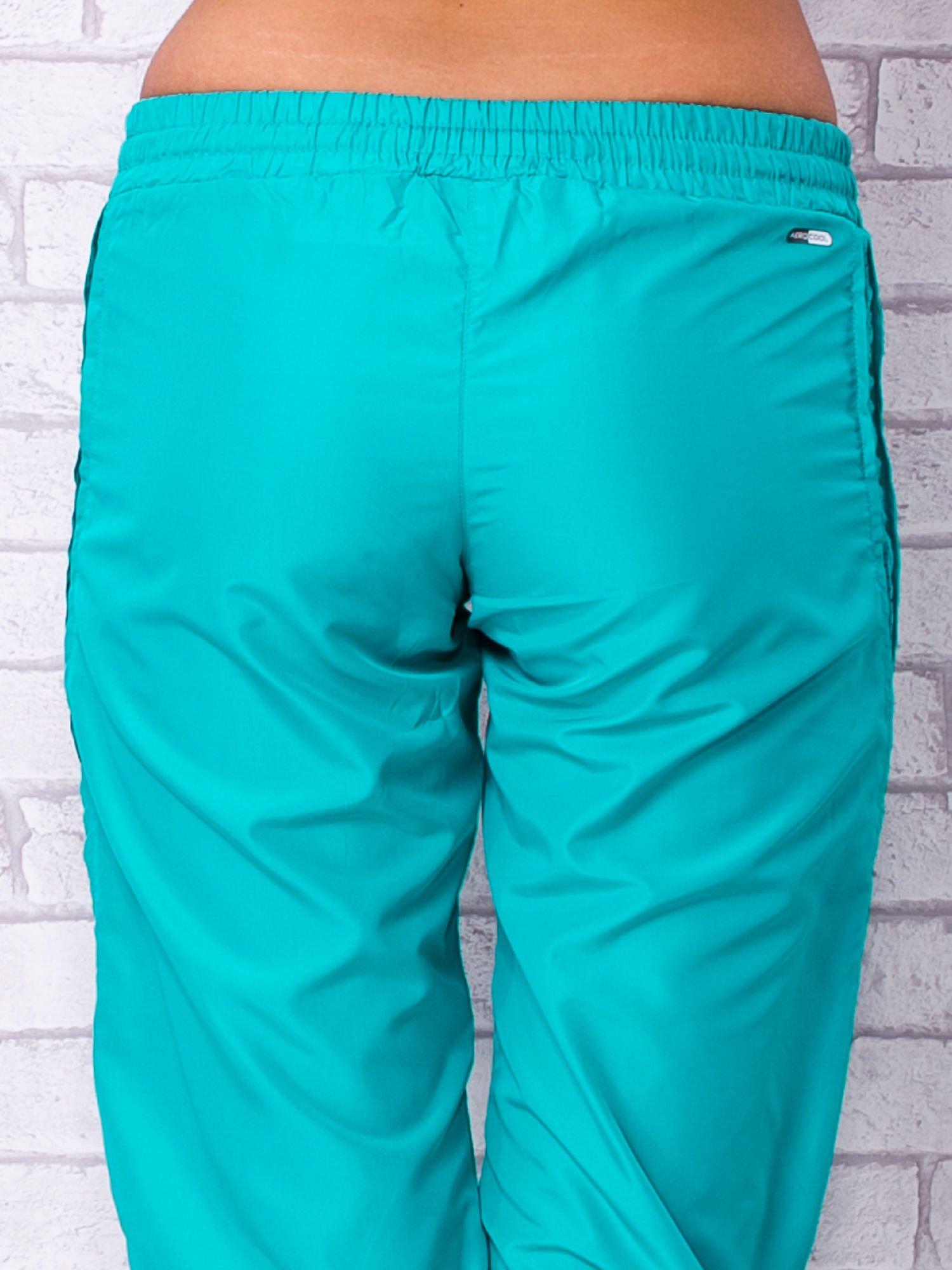 Zielone spodnie sportowe capri z siateczką                                  zdj.                                  6