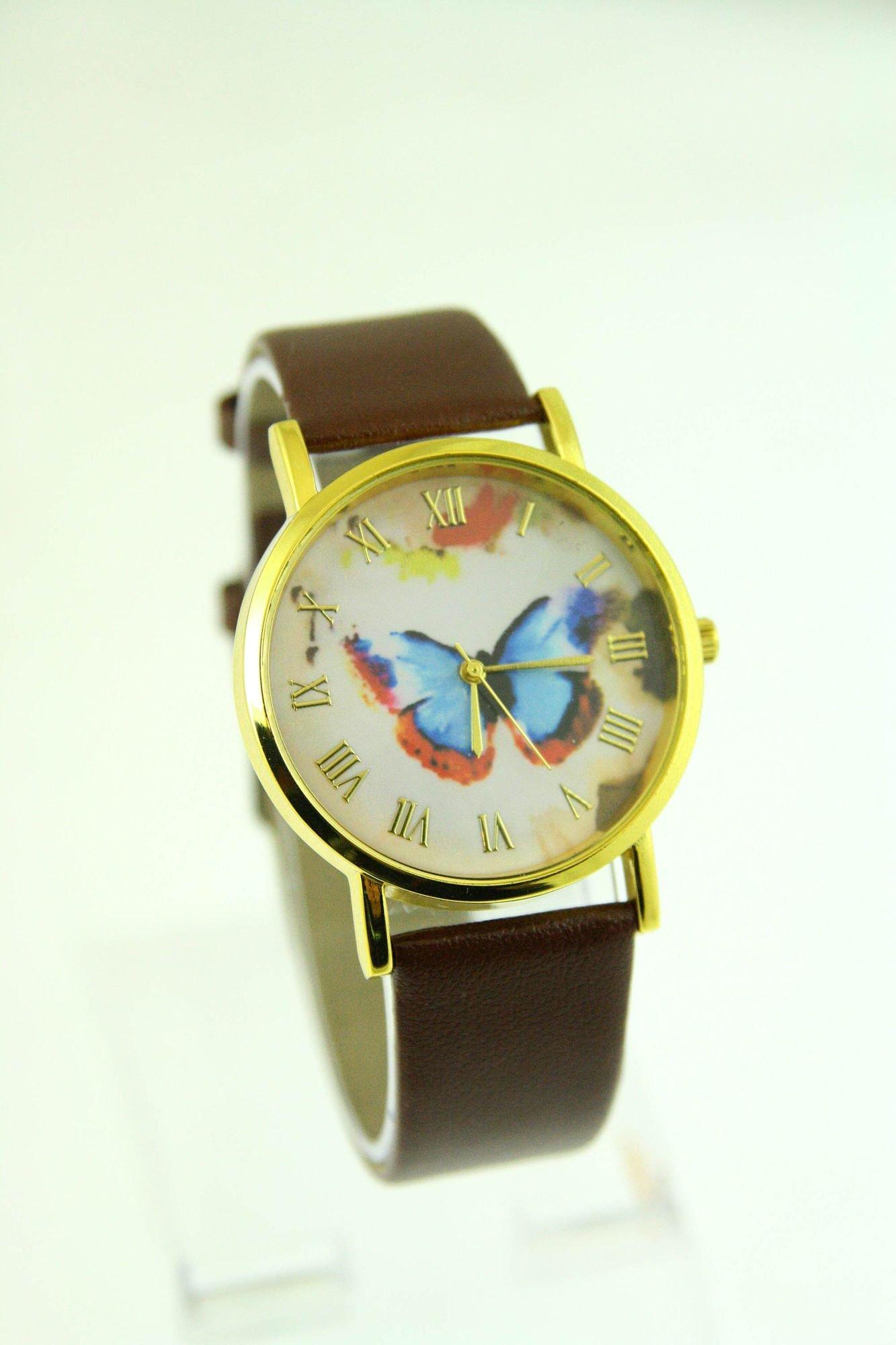 Złoty zegarek damski na brązowym pasku                                  zdj.                                  1
