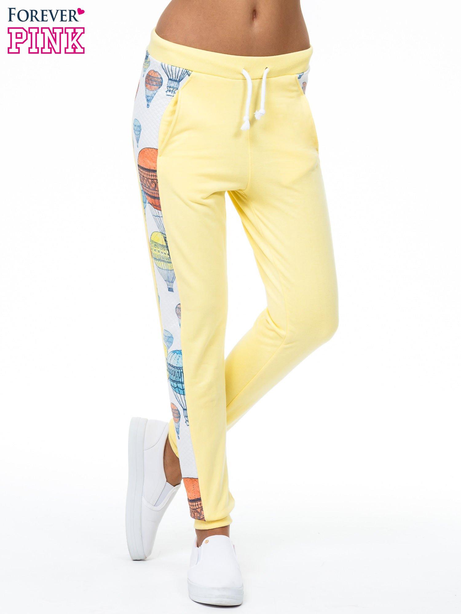 Żółte spodnie dresowe z lampasem w balony                                  zdj.                                  1