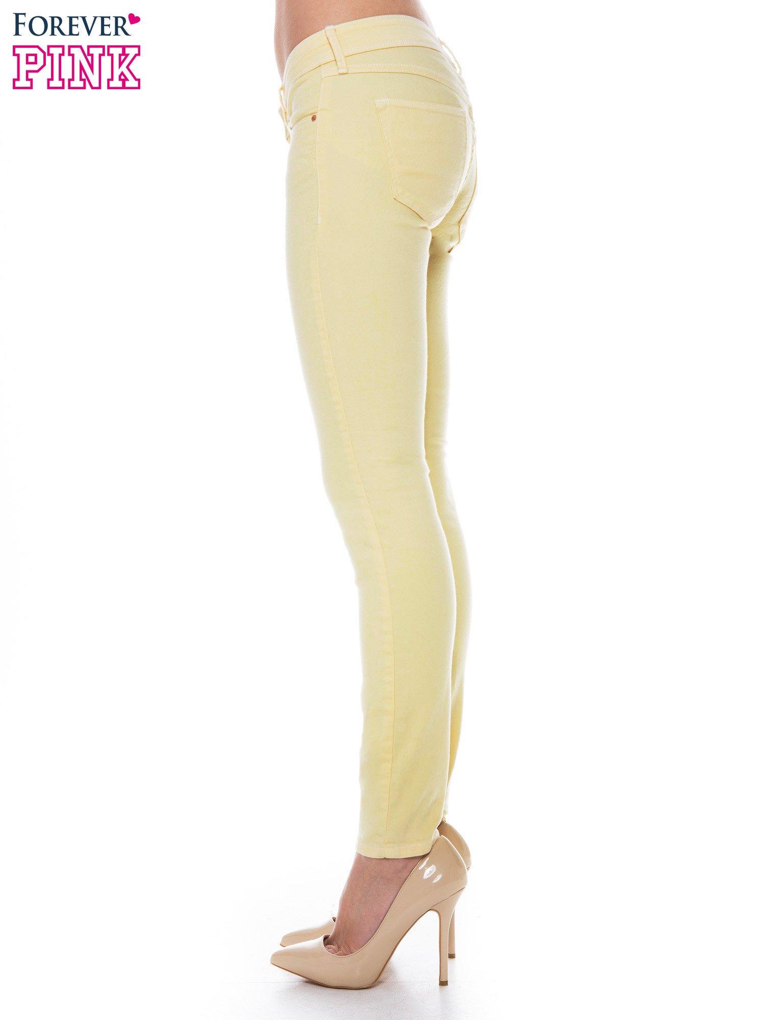 Żółte spodnie jeansowe typu rurki                                  zdj.                                  3