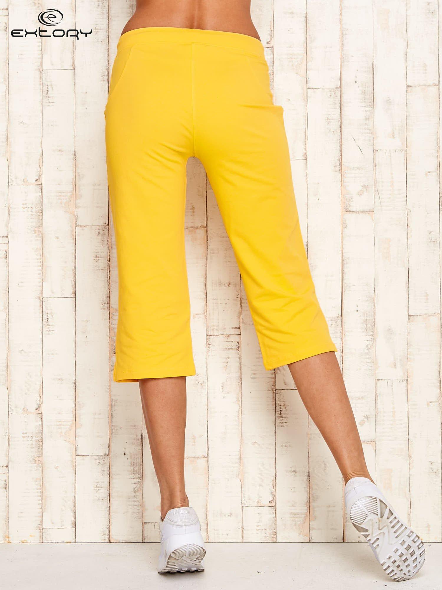 Żółte spodnie sportowe capri