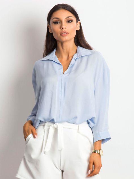 Niebieska bluzka o luźnym kroju                              zdj.                              1