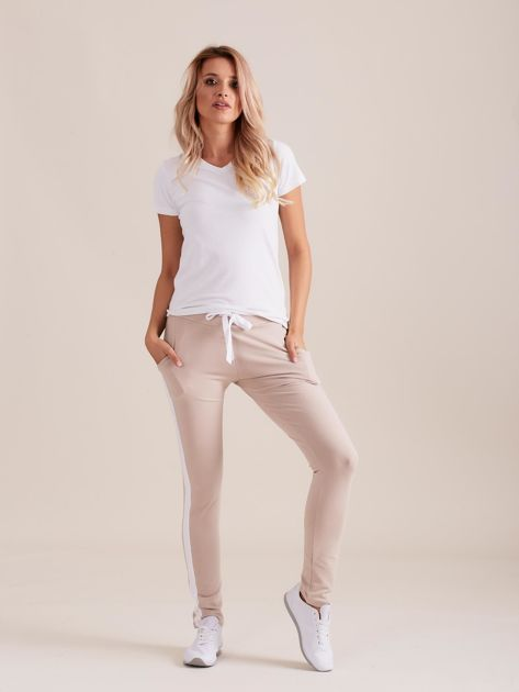 Bawełniane spodnie dresowe z lampasami beżowe                              zdj.                              4