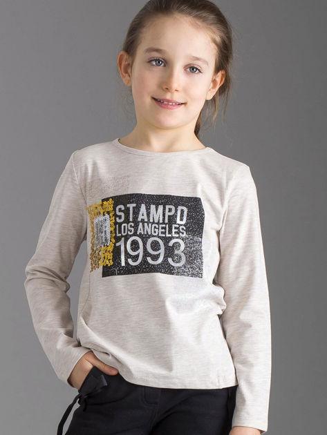 Beżowa bluzka dziewczęca z nadrukiem i cekinami