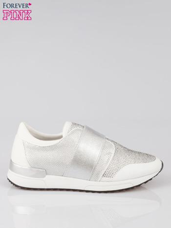 Białe buty sportowe z dżetami