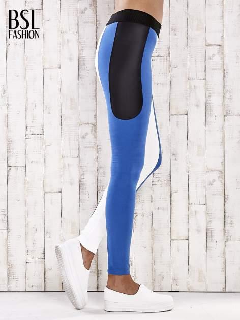 Biało-niebieskie legginsy z modułami                                  zdj.                                  4