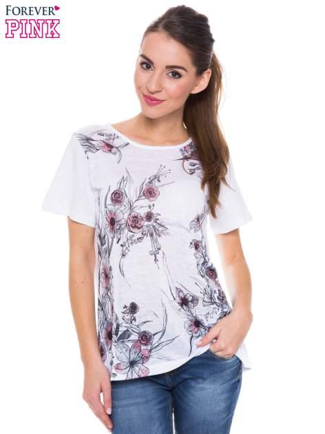 Biały t-shirt z czarnym nadrukiem roślinnym                                  zdj.                                  1