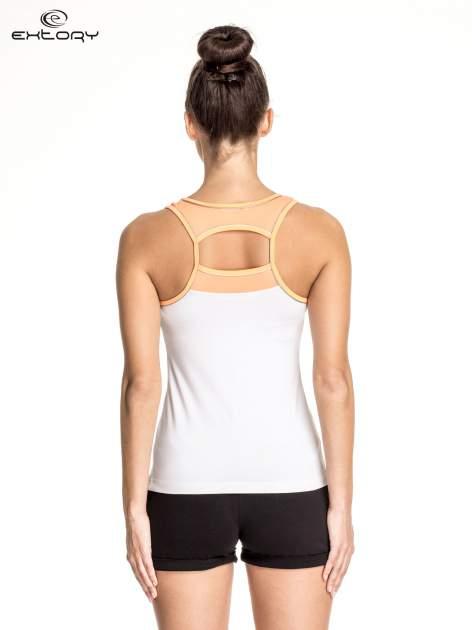 Biały top sportowy V-neck z pomarańczową lamówką                                  zdj.                                  4