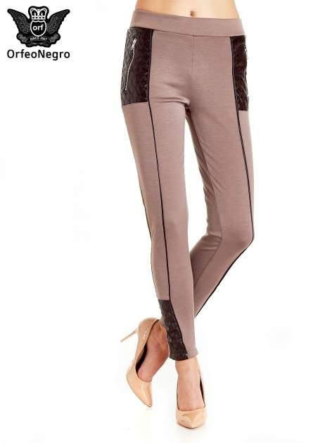 Brązowe spodnie w stylu motocyklowym ze skórzanymi wstawkami i suwakami                                  zdj.                                  1