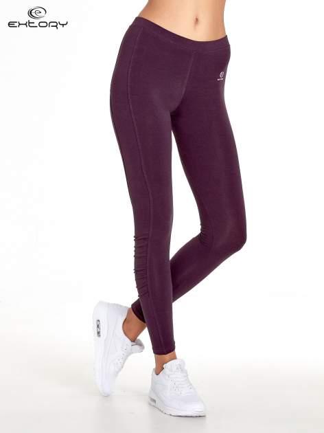 Ciemnofioletowe legginsy sportowe z drapowaniem                                  zdj.                                  1