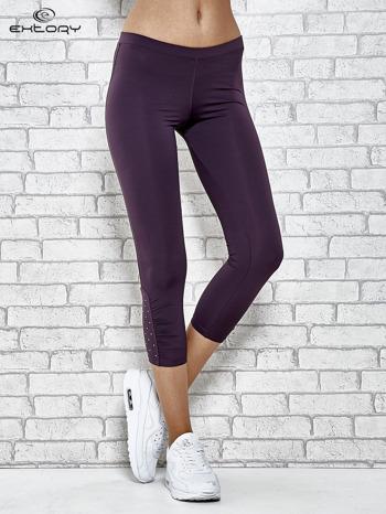 Ciemnofioletowe legginsy sportowe z dżetami na dole nogawki                                  zdj.                                  1