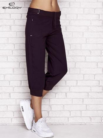 Ciemnofioletowe spodnie dresowe capri z wszytymi kieszeniami                                  zdj.                                  1
