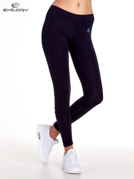 Ciemnogranatowe legginsy sportowe z drapowaniem