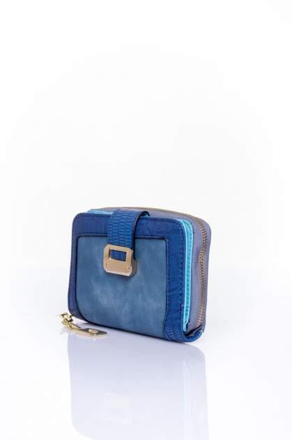 Ciemnoniebieski portfel z ozdobną złotą klamrą                                  zdj.                                  3