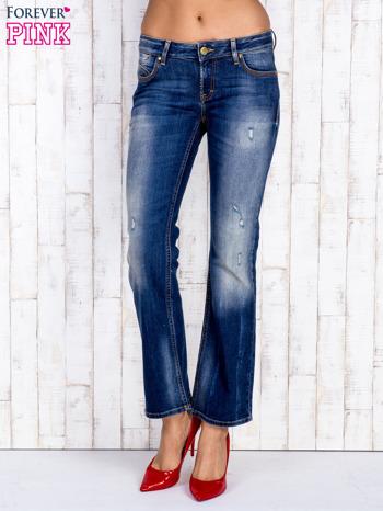 Ciemnoniebieskie spodnie dzwony jeansowe z przetarciami                                  zdj.                                  1