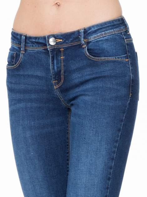 Ciemnoniebieskie spodnie typu skinny jeans z cieniowaniem                                  zdj.                                  5