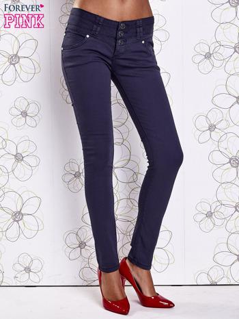 Ciemnoniebieskie strechowe spodnie skinny z kieszeniami                                  zdj.                                  1