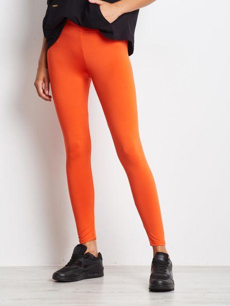 Ciemnopomarańczowe długie cienkie legginsy do biegania                              zdj.                              3