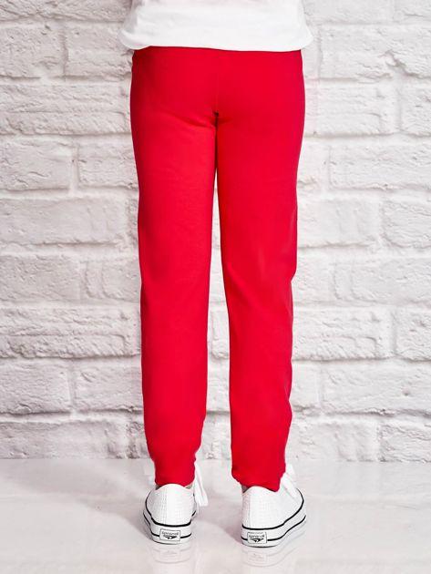 Ciemnoróżowe spodnie dresowe dla dziewczynki z motywem jednorożca                                  zdj.                                  3