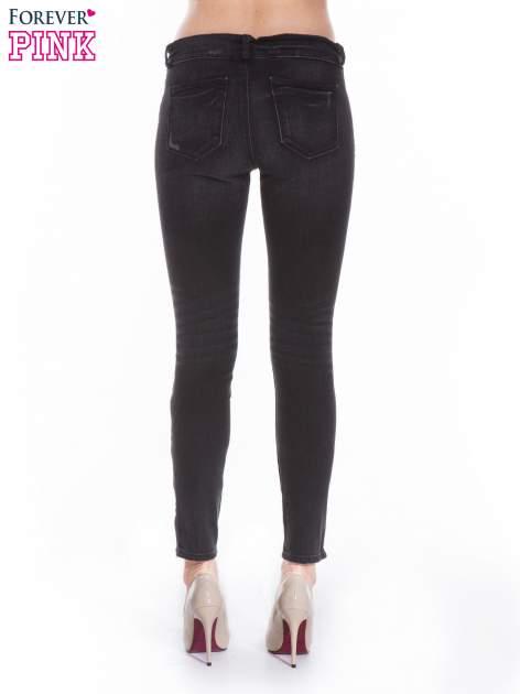 Ciemnoszare spodnie jeansowe typu skinny z suwakami na górze i przy nogawkach                                  zdj.                                  2