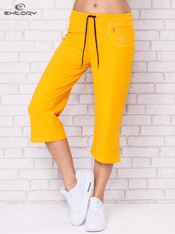 Ciemnożółte spodnie sportowe capri